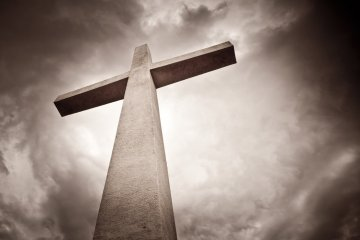 Sepia Tone Cross on Stormy Background