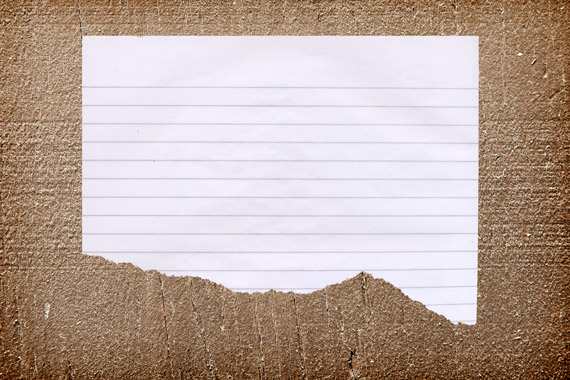 Realistic Torn Paper Note On A Wood Background