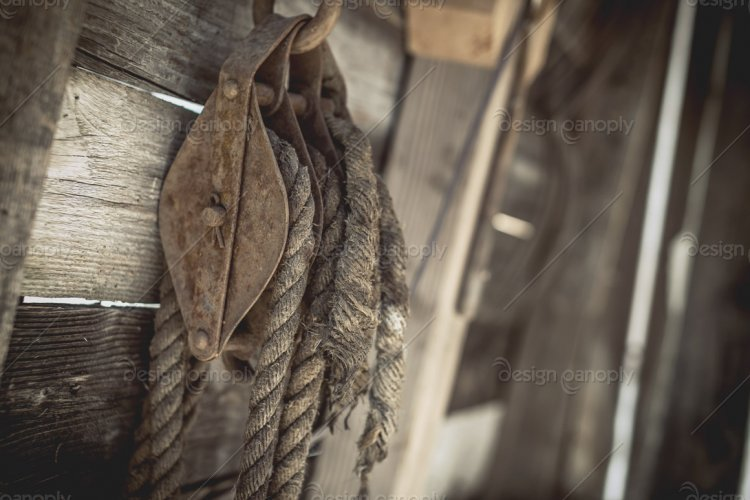 Rusty Pulley with Weathered Rope